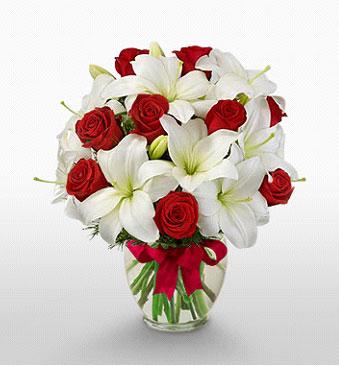 Bitlis hediye çiçek yolla  1 dal kazablanka 11 adet kırmızı gül vazosu